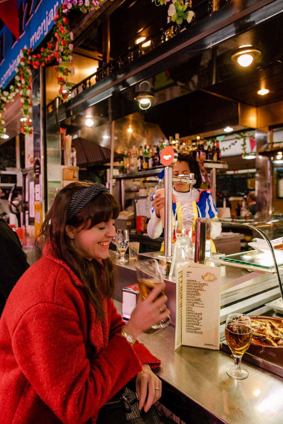 Enjoying a caña at a bar is a fun local experience in Barcelona