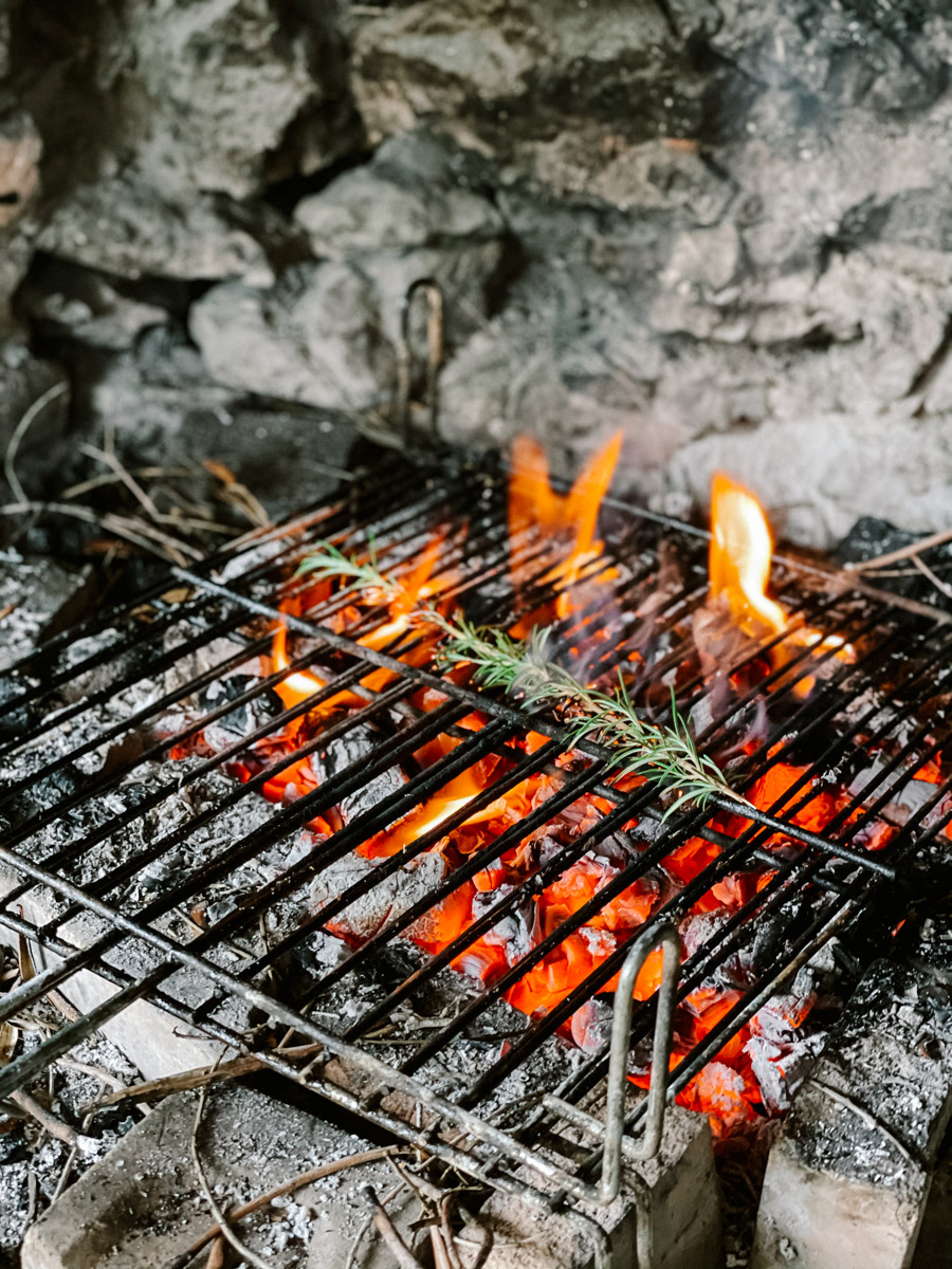 Roasting rosemary for a lovely smell. BBQ dinner in Spain